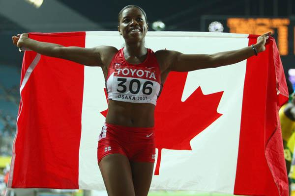 Perdita Felicien of Canada celebrates winning silver in the women's 100m Hurdles (Getty Images)
