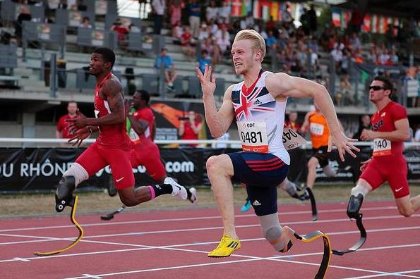 Jonnie Peacock winning the 100m T44 at the 2013 IPC Athletics World Championships (IPC Athletics World Championships Lyon 2013)