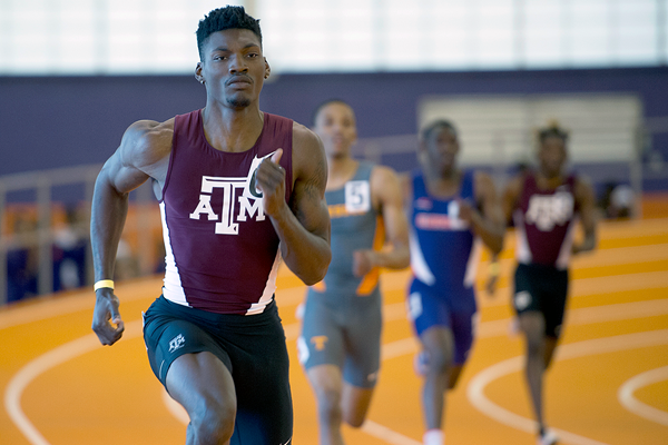 Fred Kerley on his way to winning the 400m (Shawn Price / Texas A&M University)