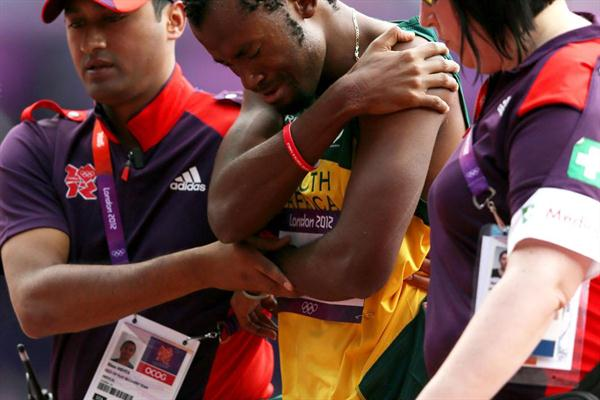 Ofentse Mogawane of South Africa receives treatment during the Men's 4 x 400m Relay Round 1 heats on Day 13 of the London 2012 Olympic Games at Olympic Stadium on August 9, 2012 (Getty Images)