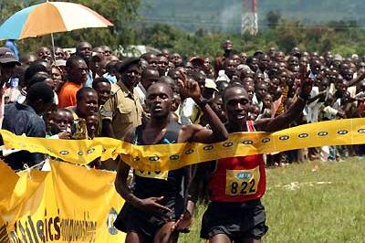 Boniface Kiprop and Moses Kipsiro both salute the win - Kiprop was declared the winner of the Ugandan XC (Daniel Senfuma)