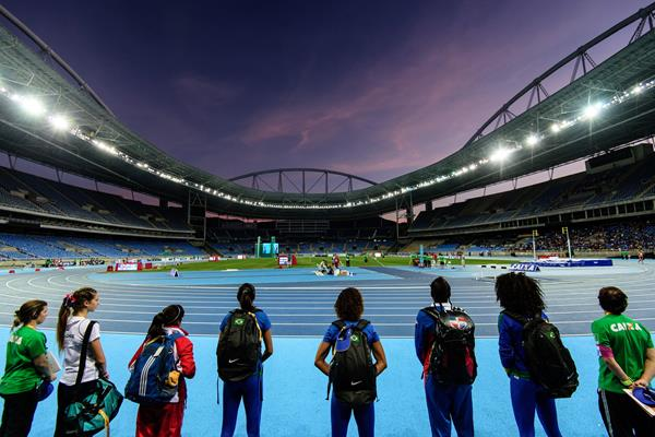 Athletes look out on the Olympic Stadium in Rio (Getty Images / AFP)