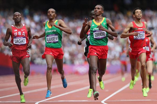 Dejen Gebremeskel of Ethiopia leads Bernard Lagat of the United States and Yenew Alamirew of Ethiopia in the Men's 5000m Round 1 Heats on Day 12 of the London 2012 Olympic on 08 August 2012 (Getty Images)