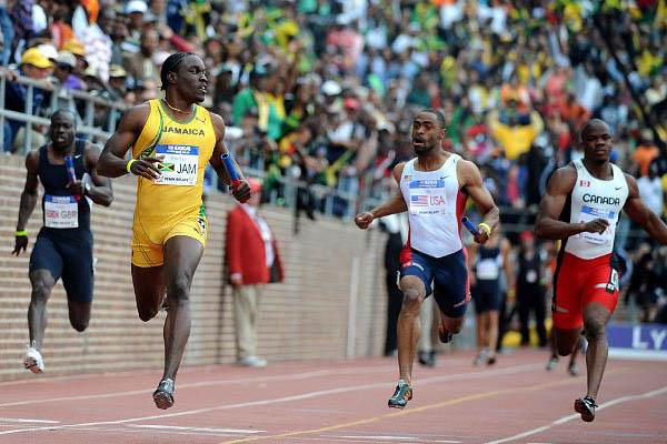 Dwight Thomas (l) anchoring the victorious Jamaican 4x100m Relay at the Penn Relays. U.S. anchor Tyson Gay was fourth. (Kirby Lee)