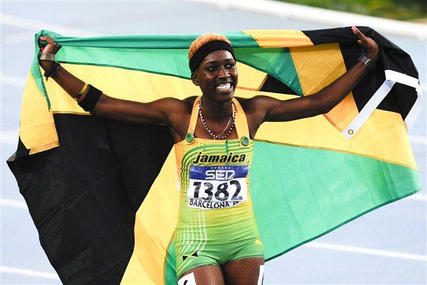 Janieve Russell of Jamaica celebrates after winning the Women's 400 metres Hurdles Final on the day five of the 14th IAAF World Junior Championships in Barcelona on 14 July 2012 (Getty Images)
