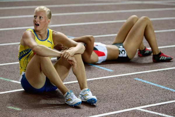 Carolina Kluft of Sweden checks her time to confirm she has taken overall victory following the 800m of the Heptathlon (Getty Images)