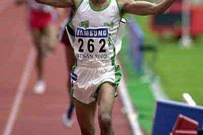 Moukhled Al-Otaibi wins Asian Games 10,000m (Gray Mortimore)