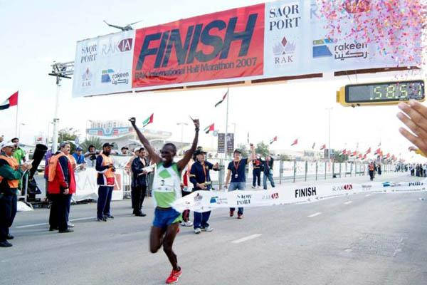 Sammy Wanjiru celebrates his Half Marathon World Record in Ras al Khaimah (Pat Butcher)