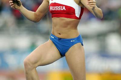 Yelena Isinbayeva of Russia celebrates winning gold in the women's Pole Vault (Getty Images)