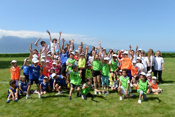 Children and athletes at the IAAF / Nestlé Kids' Athletics demonstration in Vevey, Switzerland (Jiro Mochizuki)
