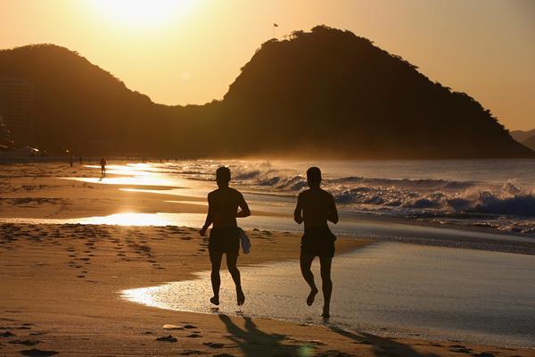 Runners on Copacabana Beach (Getty Images)