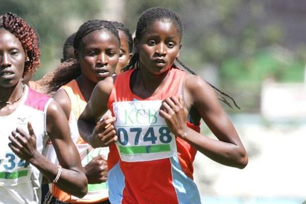 Winner Grace Nyemweno (0748) keeps in touch with the women's 8km race leadersduring the KCB National Cross Country Series race at Kisii (Mohammed Amin)