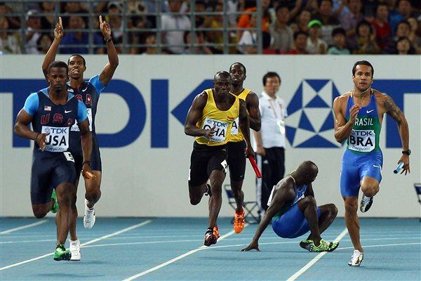 (L-R) Travis Padgett of United States receives the relay baton from team mate Maurice Mitchell next to Aziz Zakari of Ghana and Bruno de Barros of Brazil as they compete in the men's 4x100 metres heats  (Getty Images Steele)