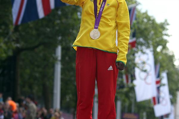 Gold medalist Tiki Gelana of Ethiopia poses on the podium during the medal ceremony for the Women's Marathon during the Women's Marathon on Day 9 of the London 2012 Olympic Games on August 5, 2012 (Getty Images)