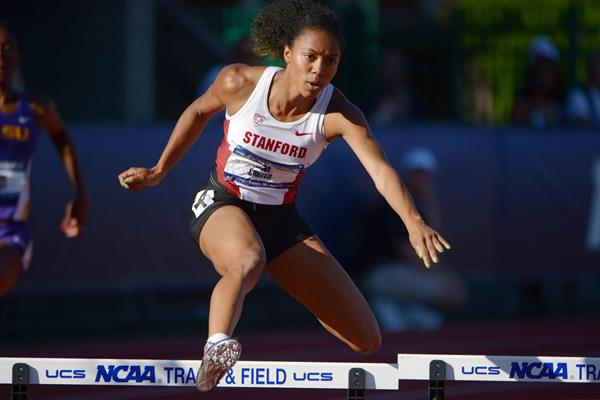 Kori Carter smashes her PB with a 53.21 win in the 400m hurdles at the 2013 NCAA Championships (Kirby Lee)