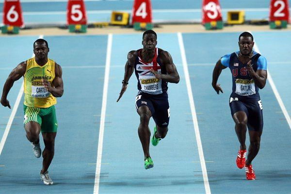(L-R) Nestor Carter of Jamaica, Dwain Chambers of Great Britain and Justin Gatlin of the United States compete in the Men's 60 Metres Final during day Two - WIC Istanbul (Getty Images)