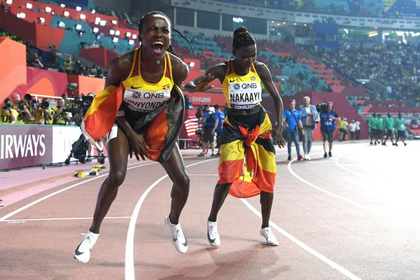All smiles - Halimah Nakaayi and Winnie Nanyondo celebrate after the women's 800m final in Doha (AFP/Getty Images)