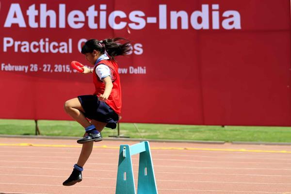 A young girl runs over the hurdles at the IAAF / Nestlé Kids' Athletics workshop in New Delhi (AFI)