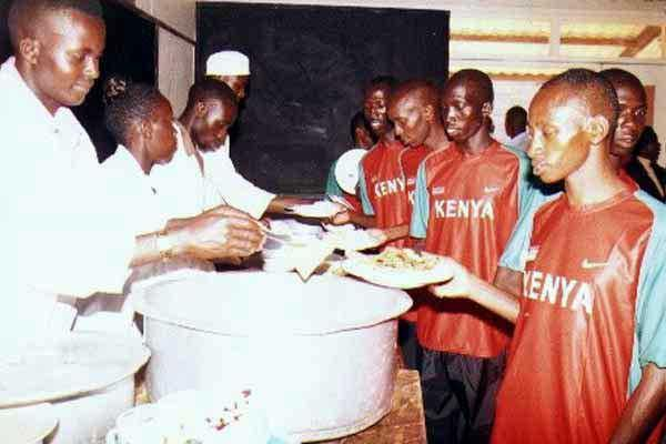 Charles Kamathi, Sammy Kipketer, Shadrack Kosgei and David Chepterit queue for the lunch (Okoth)
