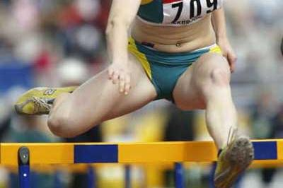 Sally McLellan of Australia wins her 100m Hurdles heat (Getty Images)
