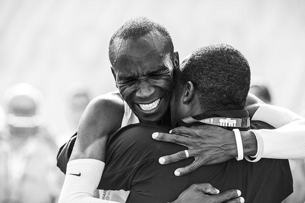 Eliud Kipchoge embraces his coach Patrick Sang after breaking the marathon world record in Berlin (Dan Vernon)