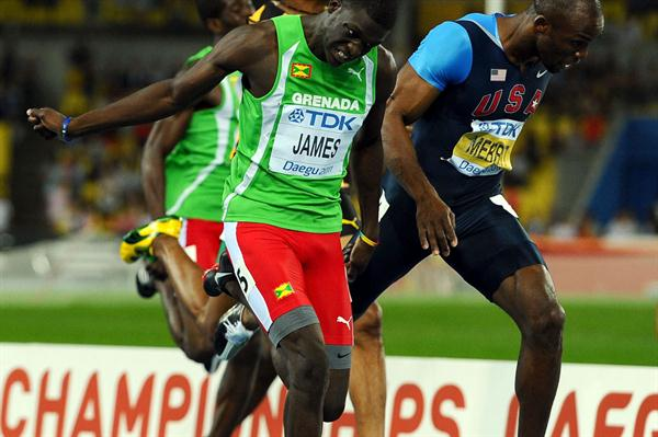 Kirani James of Grenada crosses the finish line ahead of LaShawn Merritt (R) of United States in the men's 400 metres final  (Getty Images)