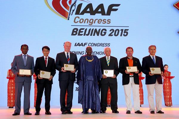 IAAF President Lamine Diack with IAAF Plaque of Merit recipients Vivian Gungaram, Tigor Tanjung, Karel Pilny, Keith Parker, Naomi Pollum (represented by Toni Green) and Lino Ramiro Varela Marmolejo at the Opening Ceremony and Dinner for the 50th IAAF Congress at the Great Hall of the People in Beijing (Getty Images)
