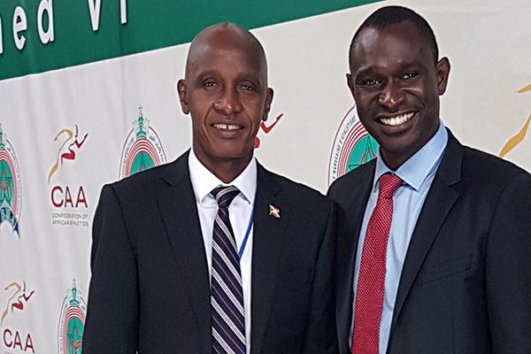 Dieudonne Kwizera, president of the Burundi Athletics Federation, with 800m world record-holder David Rudisha ()