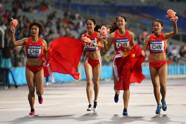 The Chinese women's 4x100m quartet celebrate their Games record at the Asian Games (Getty Images)