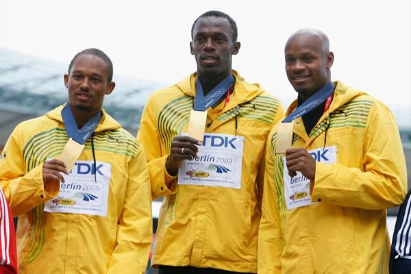 Michael Frater, Usain Bolt and Asafa Powell of Jamaica receive the gold medal in the 4x100m final at the 12th IAAF World Championships in Athletics in Berlin (Getty Images)