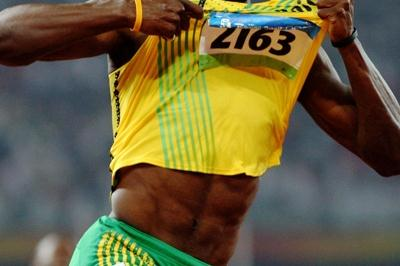Usain Bolt celebrates his 19.30 clocking (Getty Images)