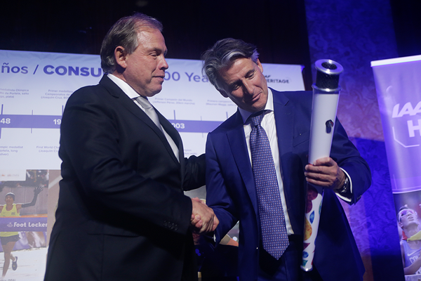 Sebastian Coe is presented with the Youth Olympic Games torch at ConSudAtle's centenary (IAAF)