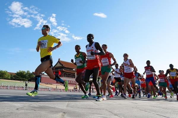 A runner from the mass 10km event leads the men's marathon at the IAAF World Championships, Beijing 2015 (Getty Images)