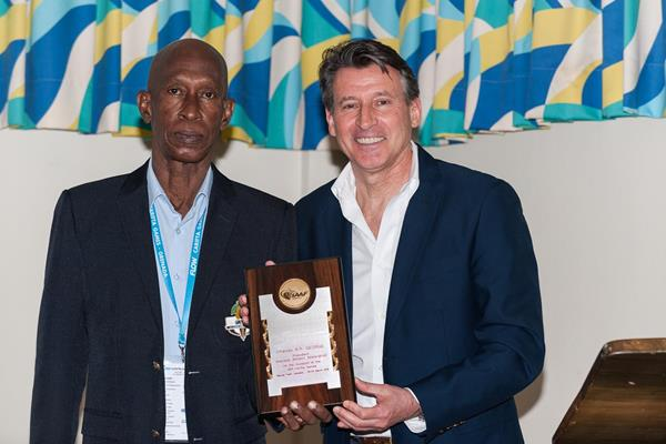 IAAF President Coe presenting a commemorative plaque to the President of the Grenada Athletics Federation Charles George (CARIFTA)