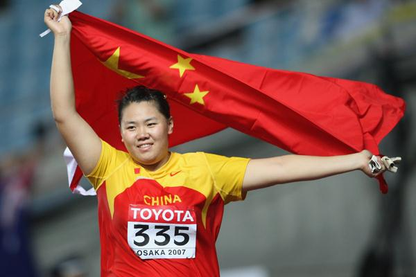 Wenxiu Zhang of China celebrates her bronze medal in the Women's Hammer Throw Final (Getty Images)