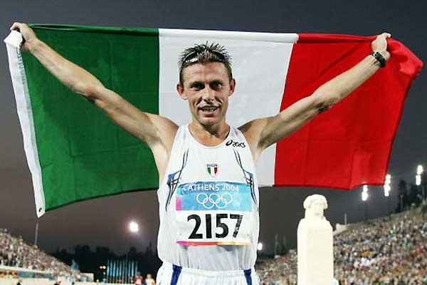 Baldini parades the Italian flag after his Olympic marathon win (Getty Images)