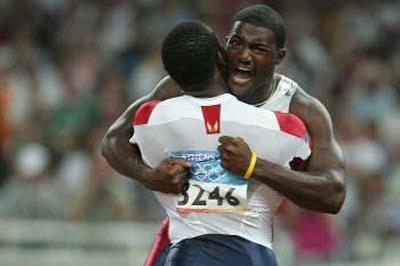 Justin Gatlin is congratulated by training partner Shawn Crawford after winning Olympic 100m title (Getty Images)