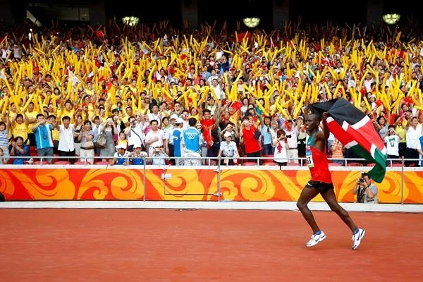 Samuel Wanjiru of Kenya celebrates his victory in the Olympic marathon (Getty Images)
