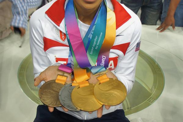Allyson Felix in Daegu with the latest additions to her medal collection (Kirby Lee)