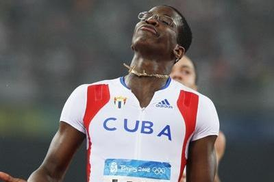 Dayron Robles of Cuba dips under 13 seconds to win Olympic sprint hurdles gold (Getty Images)