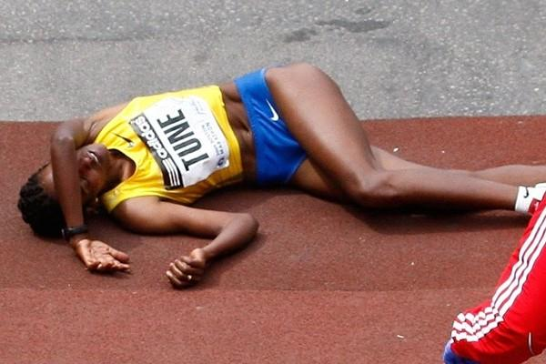 Dire Tune takes a fall soon after crossing the finish line at the Boston Marathon. She finished second. (Getty Images)