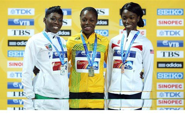 (L-R) Silver medalist Murielle Ahoure of the Ivory Coast, gold medalist Veronica Campbell-Brown of Jamaica and bronze medalist Tianna Madison of Great Britain stand on the podium during the medal ceremony for the Women's 60 Metres Final on day three - WIC Istanbul (Getty Images)