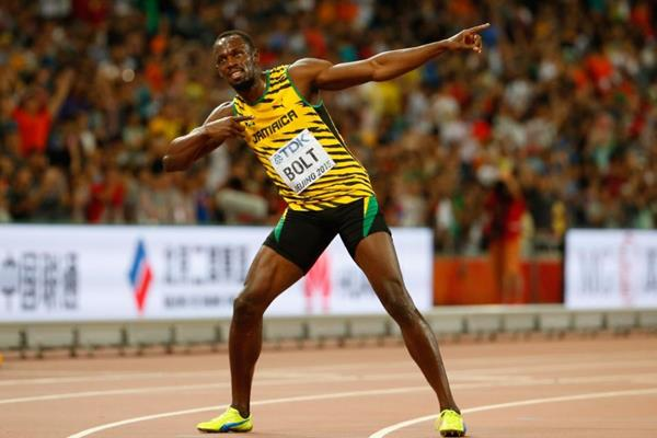 Usain Bolt celebrates his 100m victory at the IAAF World Championships, Beijing 2015 (Getty Images)