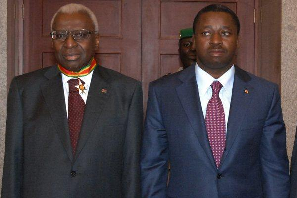 (l to r) President Lamine Diack - wearing Commander of the Order of Mono - and Togo President Faure Essozimna Gnassingbe  (IAAF)