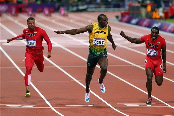 Usain Bolt of Jamaica crosses the finish line ahead of Ryan Bailey of the United States and Justin Gatlin of the United States to win the Men's 100m Semifinal on Day 9 of the London 2012 Olympic Games on 5 August 2012 (Getty Images)