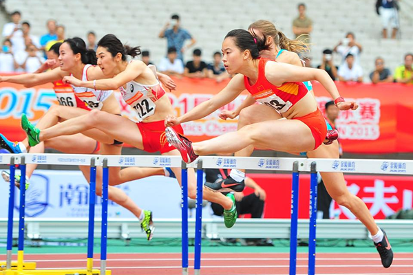 China's Wu Shuijiao on her way to winning the 100m hurdles at the Asian Championships (Organisers / Peh Siong San)