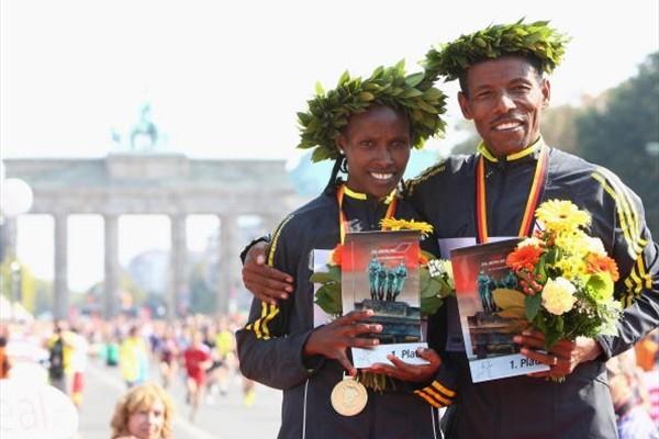 Atsede Besuye and Haile Gebrselassie after their 2009 Berlin Marathon victories (Getty Images)