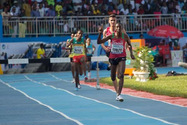 Conseslus Kipruto on the way to his first African steeplechase title in Asaba (Bob Ramsak)