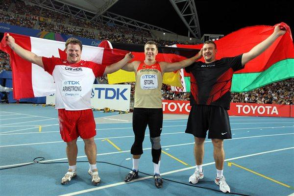 David Storl of Germany poses with Dylan Armstrong of Canada and Andrei Mikhnevich of Belarus (R) after winning the men's shot put final  (Getty Images)