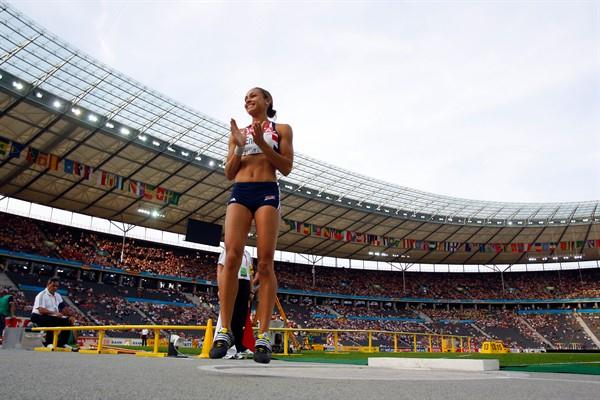 Jessica Ennis of Great Britain jumps with joy after throwing a PB in the women's Heptathlon Shot Put to continue her lead (Getty Images)